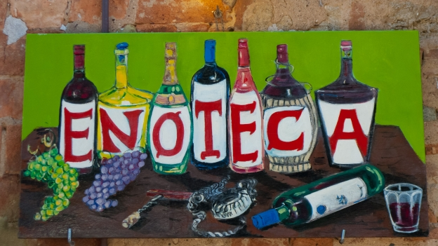 Sign outside an enoteca (wine bar) Bolgheri (Toscana)