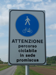 Warning sign - cycle route used by motor vehicles