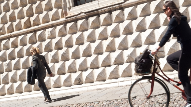 Cyclist in Ferrara (in the background is the Palazzo dei Diamanti)