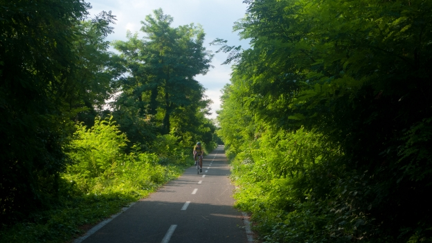 Cyclist on the Bricherasio-Barge cycleway in Piemonte