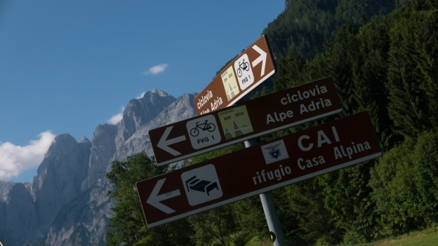 Signs on the Ciclovia Alpe-Adria Radweg near Valbruna
