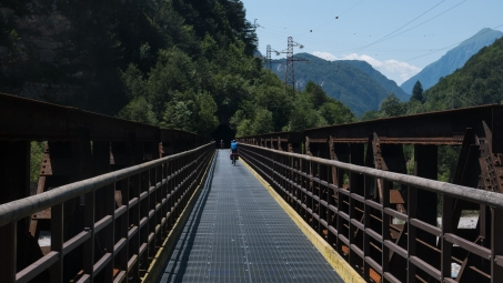 FVG1 (Ciclovia Alpe-Adria Radweg): cyclists crossing the the Fella river near Roveredo using an old railway bridge