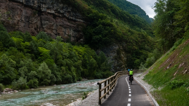 Cyclists riding the new cycleway on the banks of the Piave near Castellavazzo