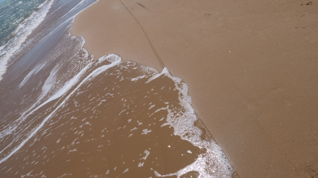 Tyre tracks on the Maganuco beach near Pozzallo