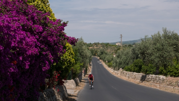 Cyclist on the road between Noto and Avola