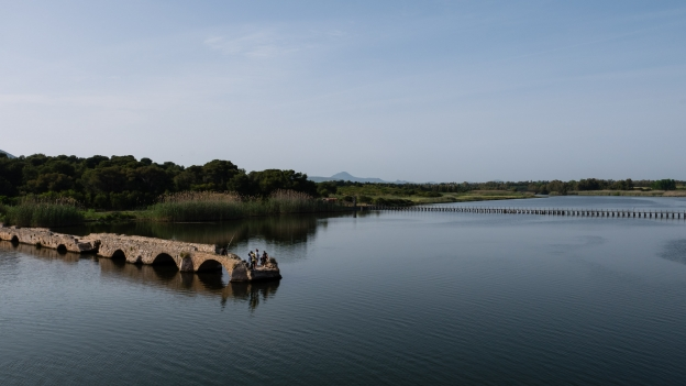 Fishing from the old Roman bridge across the Calik laguna at Fertilia