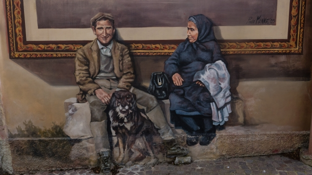 Mural in Sennariolo - Artist: Pina Monne. Note the real leather boots.