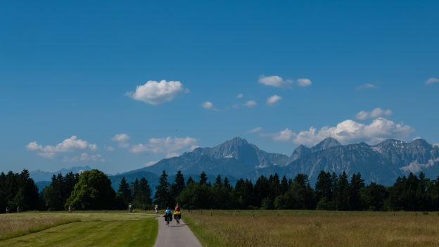 Cyclists on the Via Claudia near the Forggensee