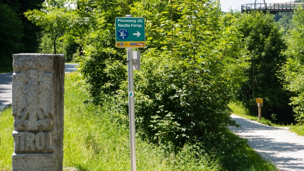 Austrian cycle route signs at the border near Füssen