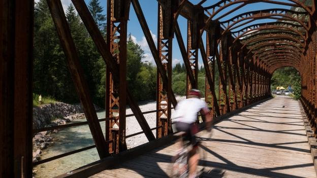 Cyclist on a bridge on the D2 cycleway near Mojstrana