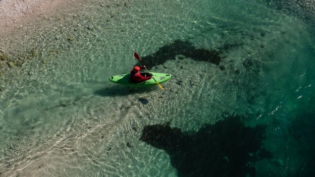 Kayaker on the Soča river near Čezsoča