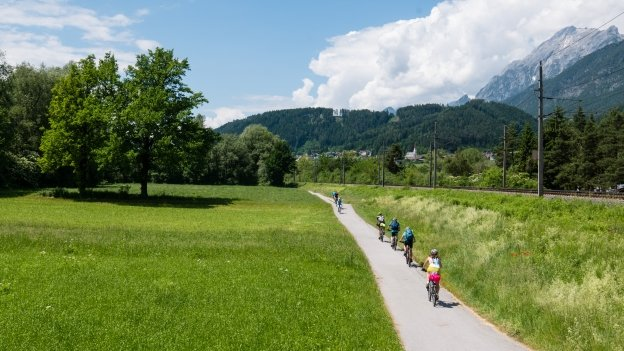 Cyclists on the Innradweg section of the München-Venezia cycle route near Vomp
