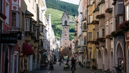 cyclists on the main street in Sterzing (Vipiteno)