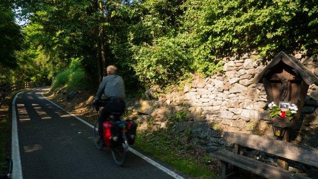 Cyclist on the Brennerradroute near Klausen (Chiusa)