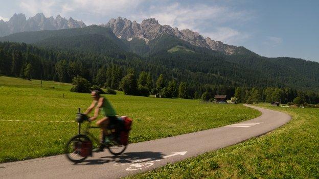 Cyclist on the Fahrradroute Pustertal near Innichen (San Candido)