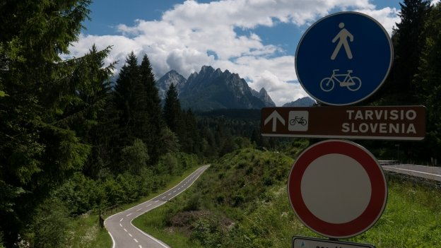 Cycle route signs on the Ciclovia Alpe Adria Radweg (FVG1) near Coccau