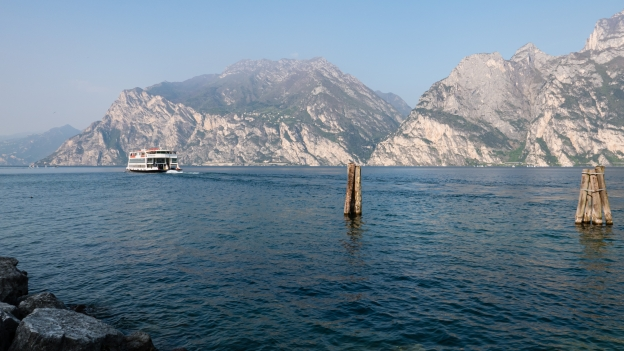 Ferryboat coming into shore at Torbole on the Lago di Garda. The picture shows one of the larger boats with more capacity for bikes