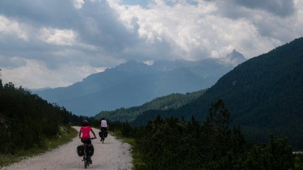 Cyclists on the Ciclabile delle Dolomiti north of Cortina d'Ampezzo