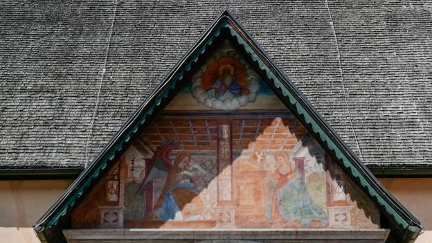 Fresco of the Annunciation on the façade of the Chiesa della Natività di Maria in Pellizzano