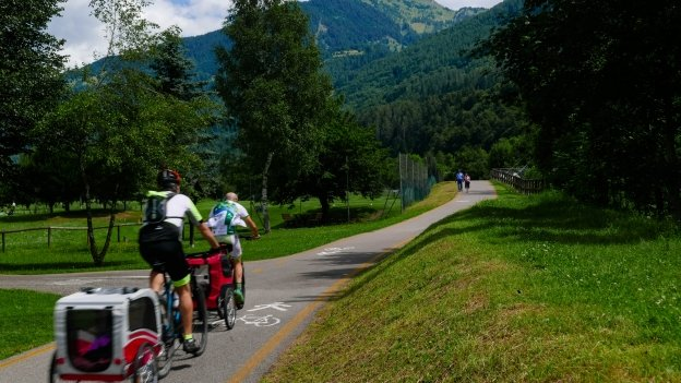 Cyclists on the Val Rendena ciclopedonale near Caderzone Terme