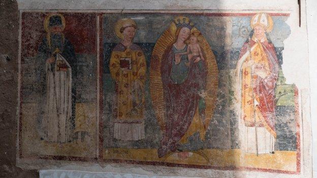 Mural in Fondo depicting the Madonna between Sant'Antonio Abate and San Vigilio