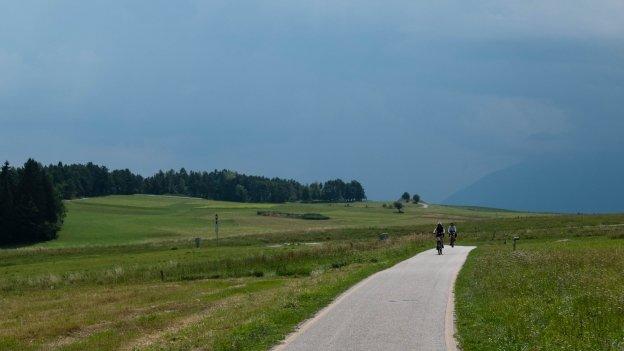 Cyclists on the Alta Val di Non cycleway near Cavareno