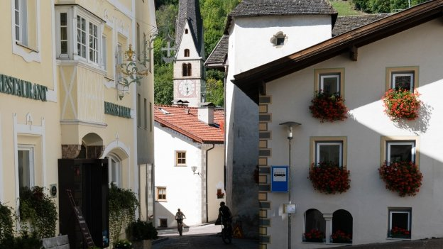 Riding through the village of Burgeis (Burgusio)