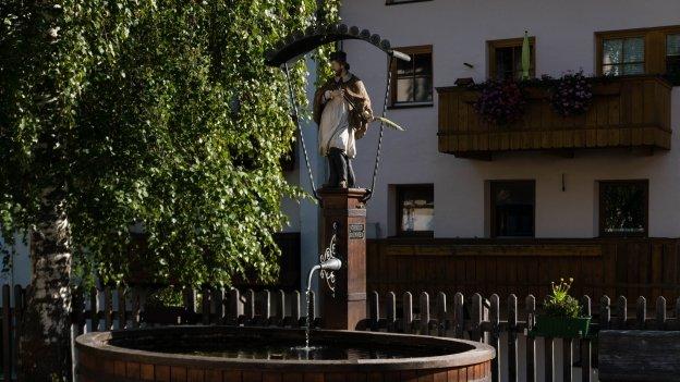 Brunnen (water fountain) in Pfunds