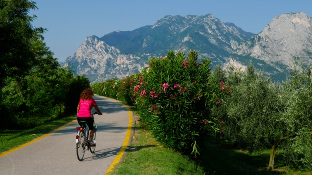 Cyclists on the Sarca cycleway near the Lago di Garda