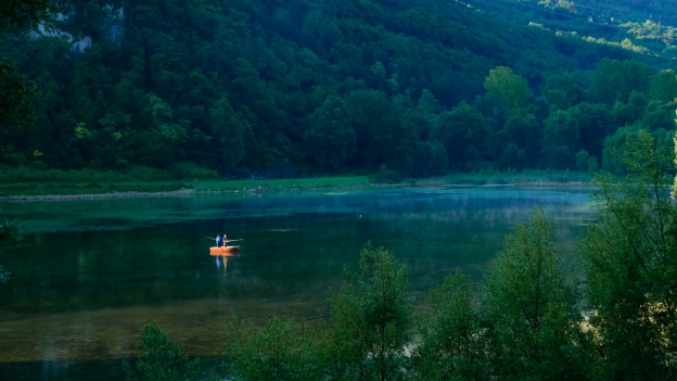 Fishing in the early morning on the Lago di Terlago
