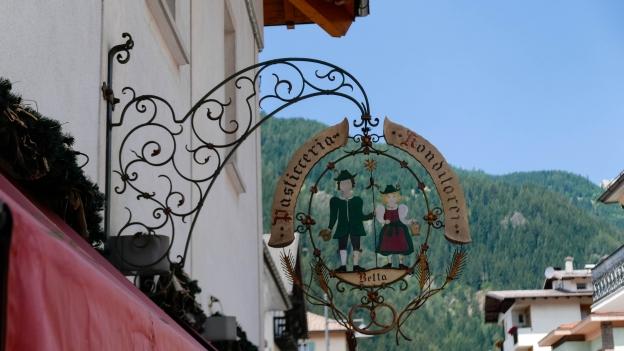 Bilingual sign in Predazzo