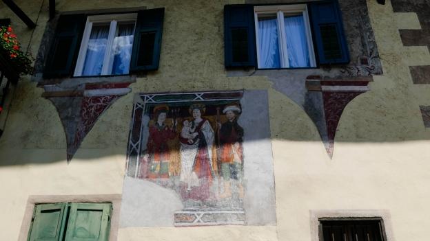 Mural on a house in the centro storico of Predazzo