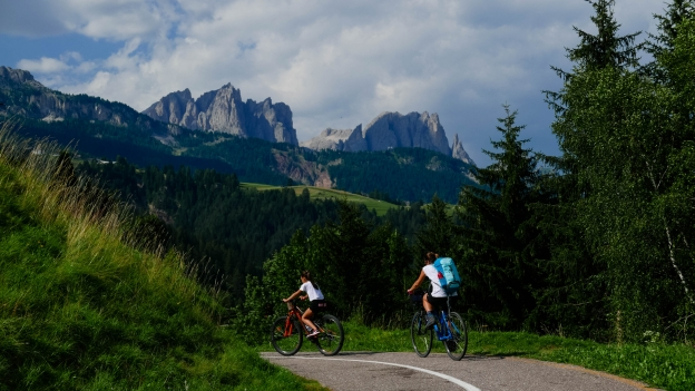 Cyclists on the Val di Fiemme Val di Fassa cycleway near  Moena