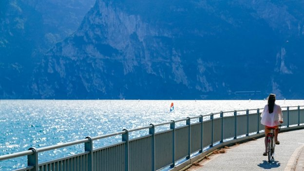 Cyclist on the lakeside cycleway near Riva del Garda